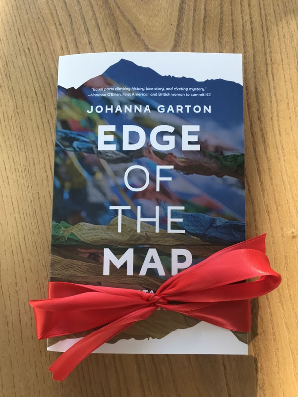 edge of the map book in red ribbon by johanna garton